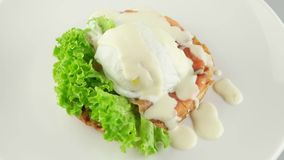 Sandwich with salmon, mozzarella and cream sauce stock footage