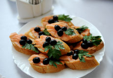 Sandwich with salmon and olives Stock Photography