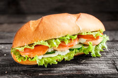 Sandwich with salmon patty and vegetables Royalty Free Stock Image