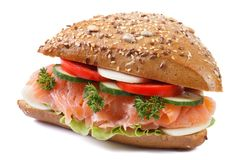 Sandwich with salmon and vegetables closeup isolated side
