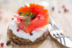 Sandwich with salted red salmon and black bread. Stock Photo