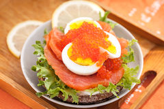 Sandwich with salted salmon, egg and red caviar Royalty Free Stock Photos