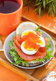 Sandwich with salted salmon, egg and red caviar Stock Image