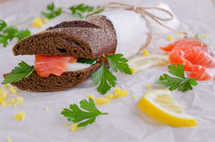 Sandwich. Of salted salmon and eggs on rye bread Stock Images