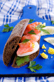 Sandwich. Of salted salmon and eggs on rye bread Royalty Free Stock Photo