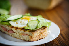 Sandwich with sausage, cheese, lettuce and eggs Stock Photos