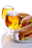 Sandwich with sausage and lager. Hot dog with a glass of lager beer on a white background Stock Photo