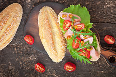 Sandwich with sausage, lettuce, tomato and arugula Royalty Free Stock Images