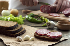 Sandwich with sausage and sliced in the background Stock Image