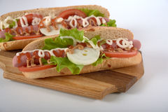Sandwich with sausage and vegetables isolated Stock Photo