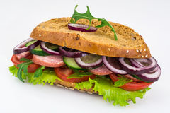 Sandwich with sausage and vegetables on whole grain bread Stock Photo