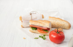 Sandwich with sausage on a white background. royalty free stock image