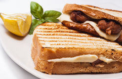 Sandwich with sausages and cheese. Sandwich with some grilled sausages and cheese Royalty Free Stock Image
