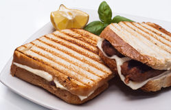 Sandwich with sausages and cheese. Sandwich with some grilled sausages and cheese Royalty Free Stock Photo