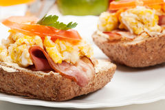 Sandwich with scrambled eggs and bacon Stock Photo