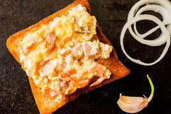 Sandwich with scrambled eggs with onion and garlic Royalty Free Stock Photo