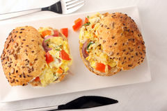 Sandwich with scrambled eggs and vegetables Stock Images