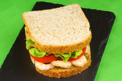 Sandwich with shrimps, pesto, lettuce and tomato Stock Photos