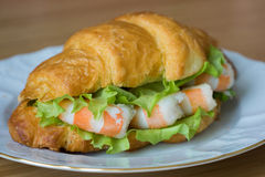 Sandwich with shrimps. And salsd in croissant close up Royalty Free Stock Images