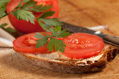 Sandwich. Slice of bread with butter and tomato Royalty Free Stock Image