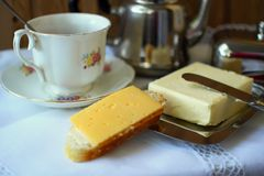 Sandwich with a slice of cheese and a cup of tea Royalty Free Stock Image