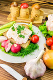 Sandwich with slice of rye bread, fresh pork lard and parsley in the plate, fresh produce, vegetables on wooden table. Royalty Free Stock Photography