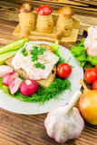 Sandwich with slice of rye bread, fresh pork lard and parsley in the plate, fresh produce, vegetables on wooden table. Stock Image