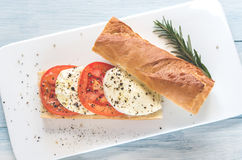Sandwich with sliced fresh tomatoes and mozzarella Royalty Free Stock Photos