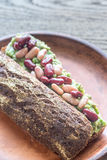 Sandwich with smashed avocado and kidney beans. On the plate Stock Image