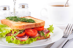 Sandwich from smoked meat and coffee Royalty Free Stock Image