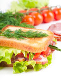 Sandwich from smoked meat and tomatoes Royalty Free Stock Image
