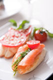 Sandwich with smoked salmon. Served on white plate Royalty Free Stock Image