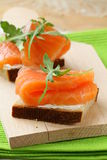 Sandwich with smoked salmon and arugula Stock Photo
