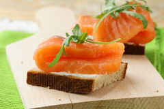 Sandwich with smoked salmon and arugula Royalty Free Stock Photo