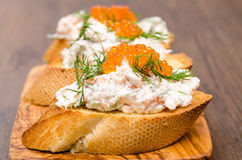 Sandwich with smoked salmon and caviar Stock Photos