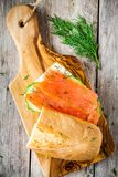 Sandwich with smoked salmon, cream cheese, cucumber and dill Stock Images