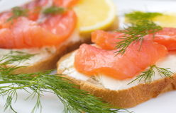 Sandwich with smoked salmon, cream cheese and lemon Royalty Free Stock Image