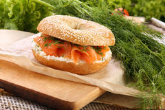Sandwich with smoked salmon and dill on a chopping board Stock Photography