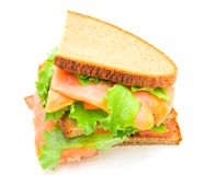 Sandwich with smoked salmon,salad and lemon Royalty Free Stock Photos