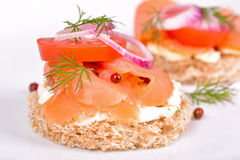 Sandwich with smoked salmon and tomato Stock Image