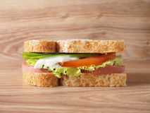 Sandwich. With smoked sausage, cheese, tomatoes and herbs Royalty Free Stock Photography