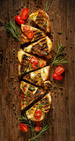 Sandwich with smoked sheep cheese, grilled zucchini, tomatoes and herbs on a wooden rustic table Stock Image