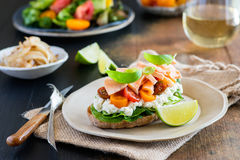 Sandwich with soft cheese, salmon and tomatoes Stock Image