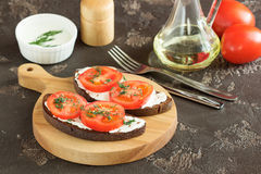 Sandwich with soft cheese. And tomatoes on dark bread Royalty Free Stock Photo