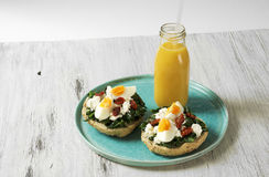 Sandwich with spinach, boiled egg and dried tomatoes Stock Photography