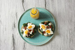 Sandwich with spinach, boiled egg and dried tomatoes Royalty Free Stock Images