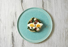 Sandwich with spinach, boiled egg and dried tomatoes Stock Photos