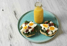 Sandwich with spinach, boiled egg and dried tomatoes royalty free stock image