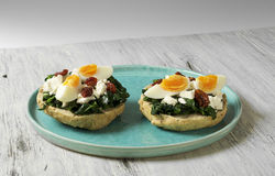 Sandwich with spinach, boiled egg and dried tomatoes royalty free stock photography
