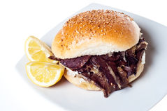 Sandwich with spleen. palermo street food. Sandwich with spleen isolated on white. typical Sicilian food Stock Image
